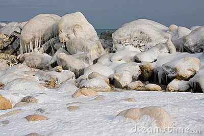 Ice rocks on sea coast in winter