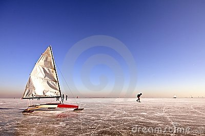 Ice sailing and skating on a cold winterday