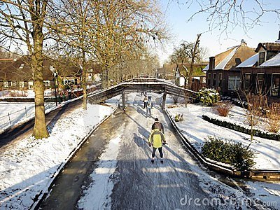 Ice skaters having recreation in Holland Editorial Stock Photo