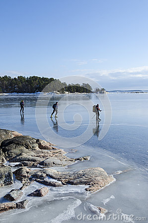 Ice skaters in Stockholm archipelago Editorial Image