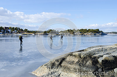Ice skaters in Stockholm archipelago