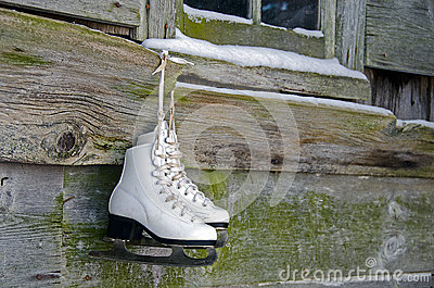 Ice skates hanging on barn