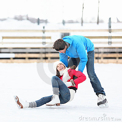 Free Ice Skating Couple Winter Fun Stock Image - 22642941