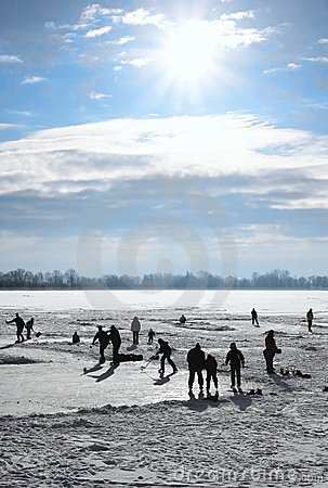 Ice-skating on frozen lake