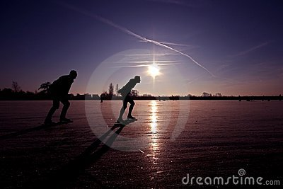 Ice skating on a frozen lake in the Netherlands