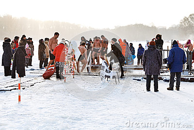 Ice swimming in Epiphany Day Editorial Stock Photo