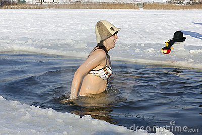 Ice swimming funs Editorial Stock Image