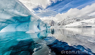 Iceberg floats in Andord Bay on Graham Land, Antarctica Stock Photo