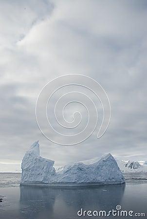 Icebergs against the overcast sky.