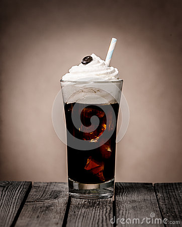 of iced coffee float topped with a whirl of creamy vanilla ice cream ...