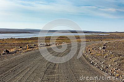 Iceland Dirt Road through Stone Field and a River.