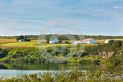 Iceland landscape with lake and farmhouse at sunny good weather