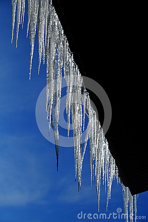 Icicles Hanging From Rooftop Of Home Melted Ice Dripping Stock ...
