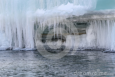 Icicles ice water river pattern Stock Photo