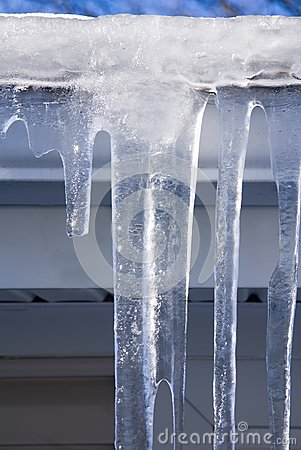 Free Icicles On The Gutter Closeup Royalty Free Stock Image - 28983266