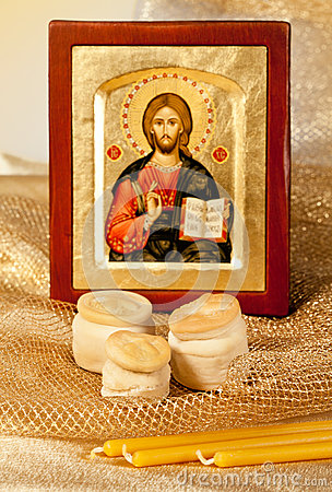Icon of Christ and religion bread  Hosts and candles