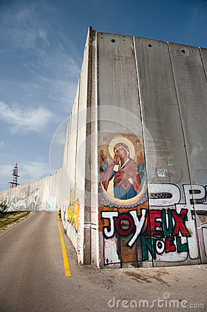 Icon on Israeli separation barrier Editorial Image