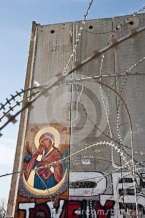 Icon on Israeli separation barrier Editorial Photo