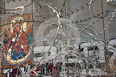 Icon on Israeli separation barrier Editorial Photography
