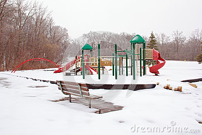 Icy playground and park bench
