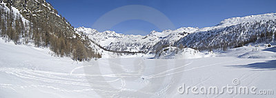 Icy winter alpine lake panorama