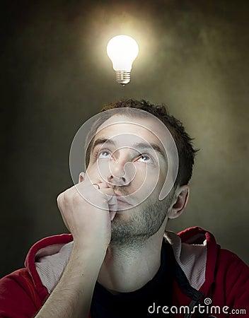Idea bulb above mans head