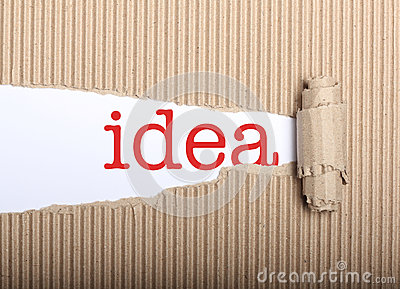 Idea text on paper and torn cardboard