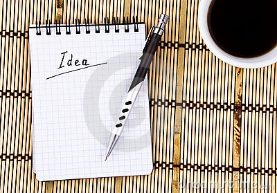 Idea written in notepad, Pen and Coffee Cup