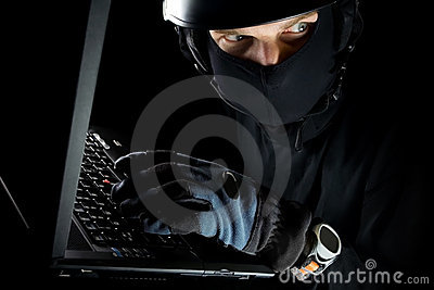Identity theft with man working on laptop