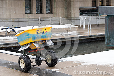 Idling salt spreader Editorial Stock Image