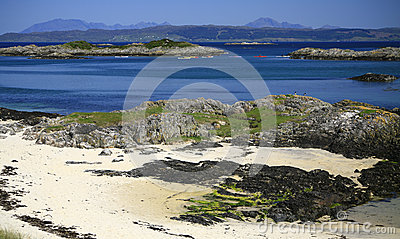 Idyllic beach, turquoise sea and Skye, Scotland
