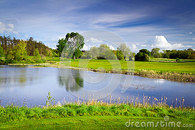 Idyllic golf course at the pond
