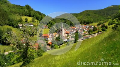 Idyllic rural landscape with a village in a valley stock video footage