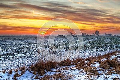 Idyllic sunset over snowy meadow