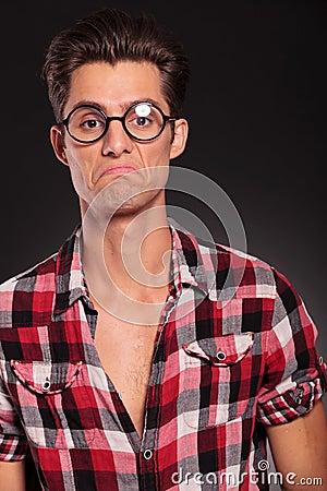 Ignorant casual man wearing glasses