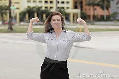 IImage of a businesswoman flexing her arms