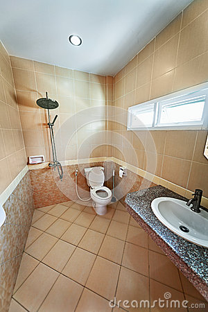 Iinterior of beige bathroom with shower
