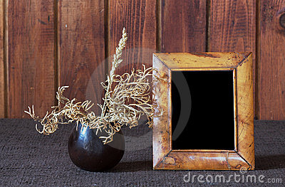 Ikebana and old photo frame