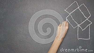 Il ` dell'apparecchio riunitore dei nastri e di scrittura della mano PENSA CREATIVO il ` sulla lavagna nera archivi video