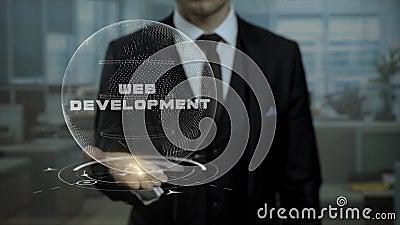 Il mediatore maschio, testa della partenza cripto di valuta mostra lo sviluppo Web di parole sulla sua mano video d archivio