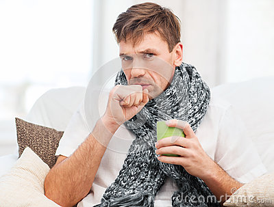 Ill man with flu at home