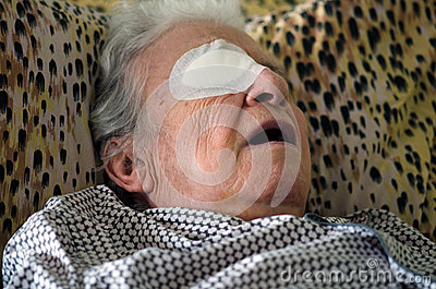 Ill person with eye bandage