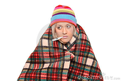 Ill woman with thermometer in her mouth