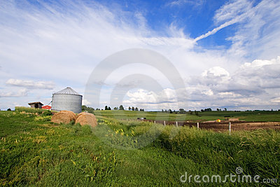 Illinois field with silo and hay bale