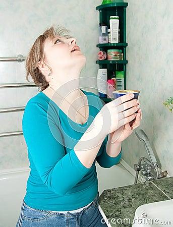 Illness woman gargles her throat
