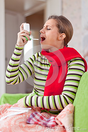 Illness woman uses spray