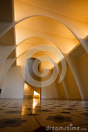 Illuminated arched ceiling above mosaic floor