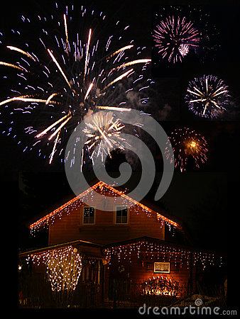 Illuminated barn and fireworks at new years eve