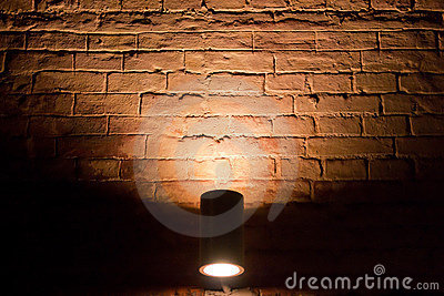 Illuminated by a brick wall in the dark