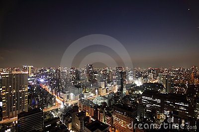 Illuminated buildings and roads in Tokyo at sunset